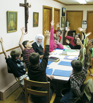 Sr. Louise Marie teaching children